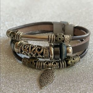 Leather and silver toned steel bracelet